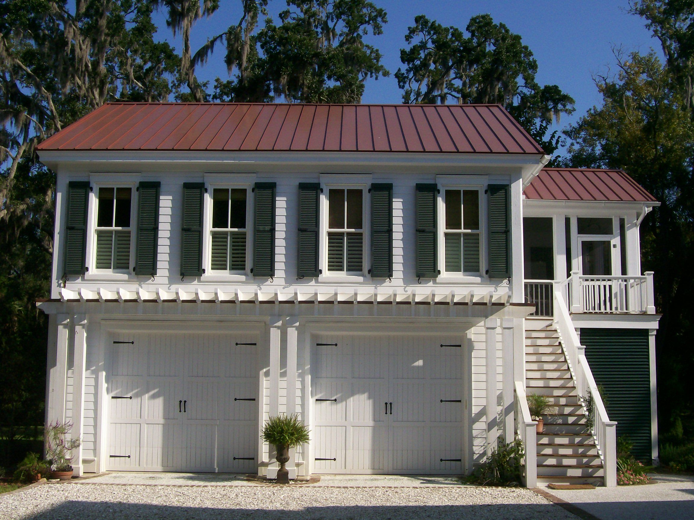 top home over garage. G0087 is a 2 car garage with living space above  The overall dimensions are