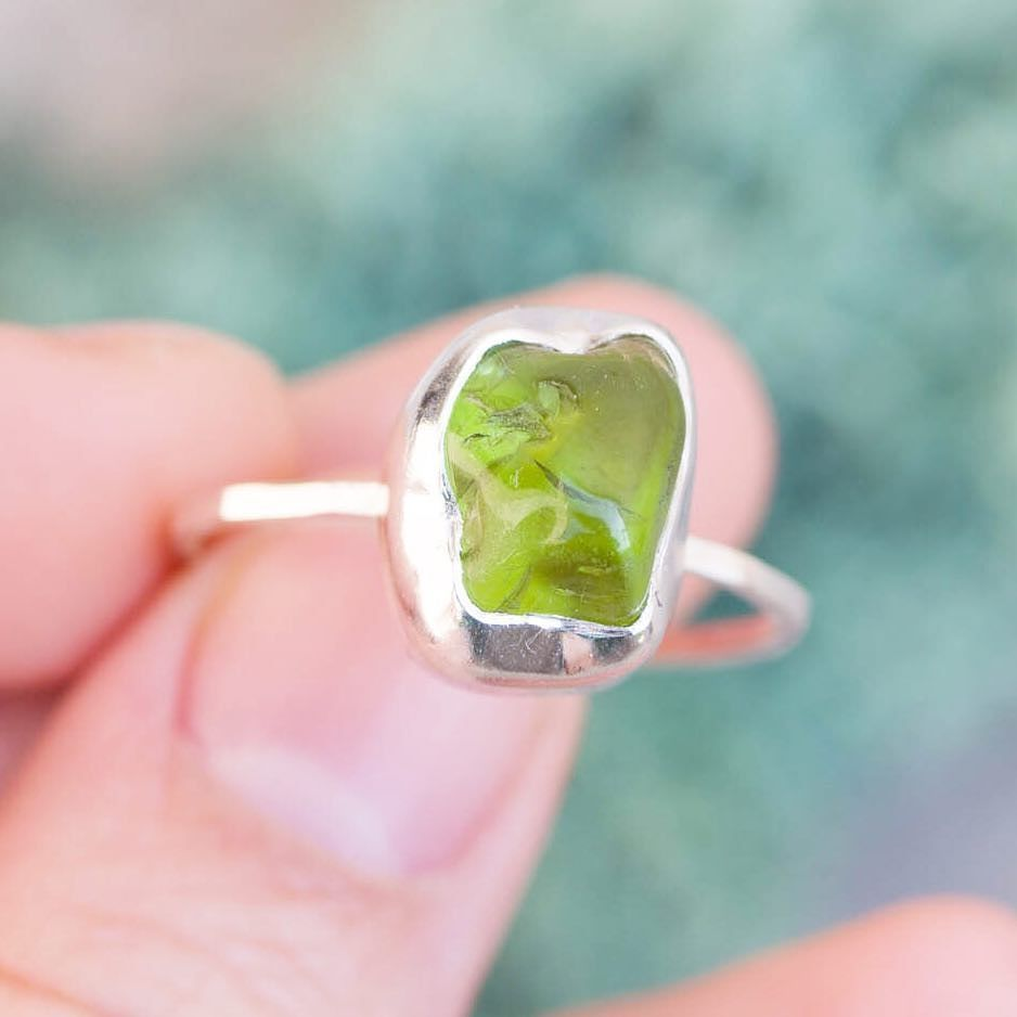 Rather big Peridot stone (at least for me ) comes as a size 9 ring with thin but sturdy band.  How is my description exercise went? Do I deserve an A grade?  #keepityours #natalkamakesjewelry #petitejoys #livecolorfully #aquietstyle #propstyling #handmadejewelry #silverjewelry #sterlingsilverjewelry #modernjewelry #gemstonejewelry #alternativebridal #stackingrings #bespokejewellery #birthstonejewelry #peridot #peridotring