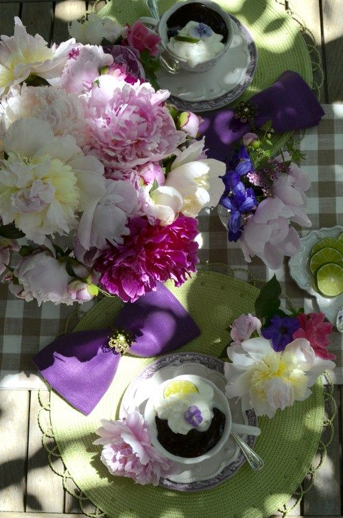 Gorgeous table in green and purple with peonies and Flourless Chocolate Cake via More Fun Less Laundry