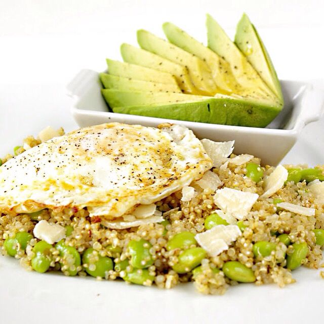 Quinoa with Edamame, Parm, and Egg  serves 1  1/2 cup cooked quinoa 1/2 cup shelled, cooked edamame 1/2 oz shaved parmigiano reggiano 1 extra-large egg 2 teaspoons olive oil pepper to taste 1/2 avocado, peeled, pitted, and sliced For recipes follow us on Facebook!