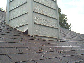 Defect Chimney Chase On Roof Had A Large Gap In The Siding At The Roof Chase Junction Toward The Eaves Siding On Cha Roof Shingles Home Inspector Shingling