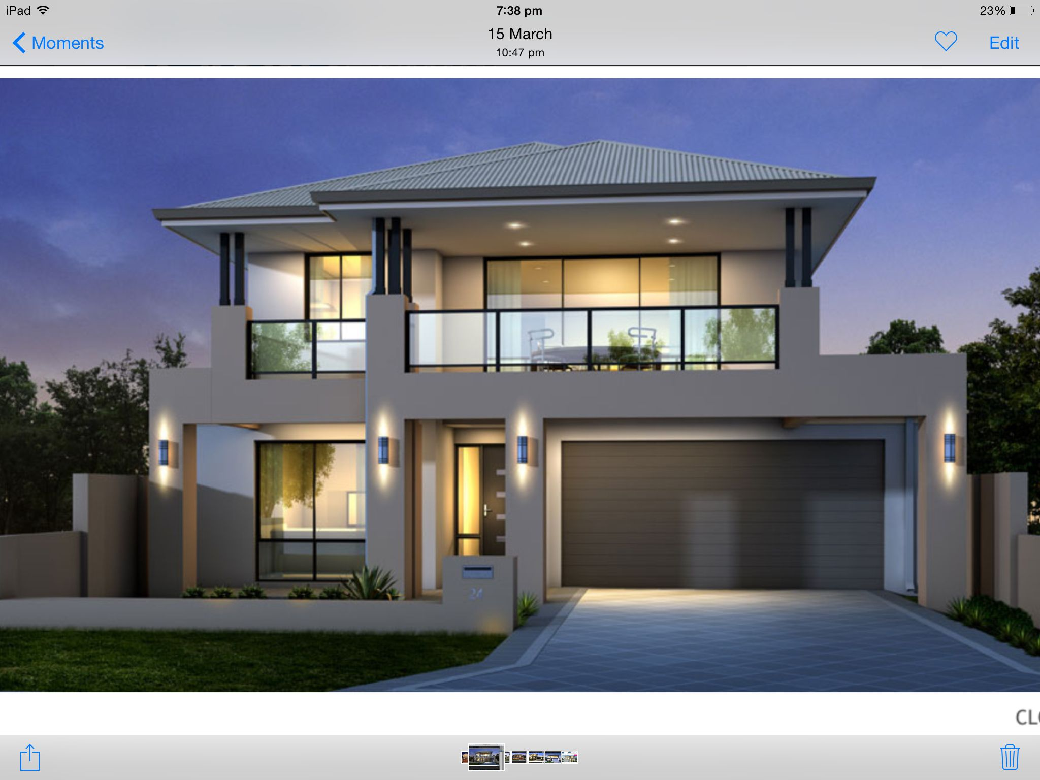 Two storey house facade, grey and black, balcony over ...