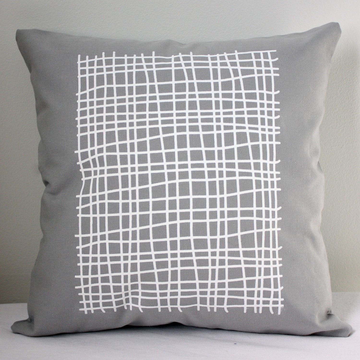 in square throw pillow light gray with grid print in white