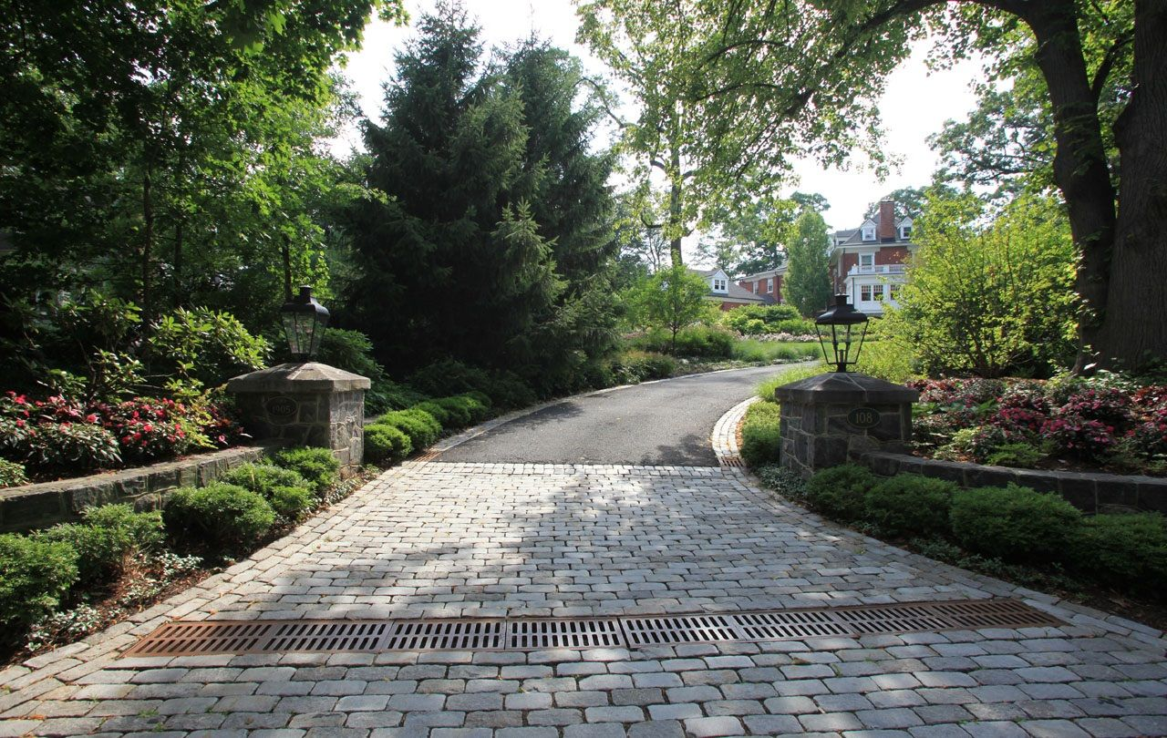 Driveway Entrance Short Hill With Block Stones Landscaping
