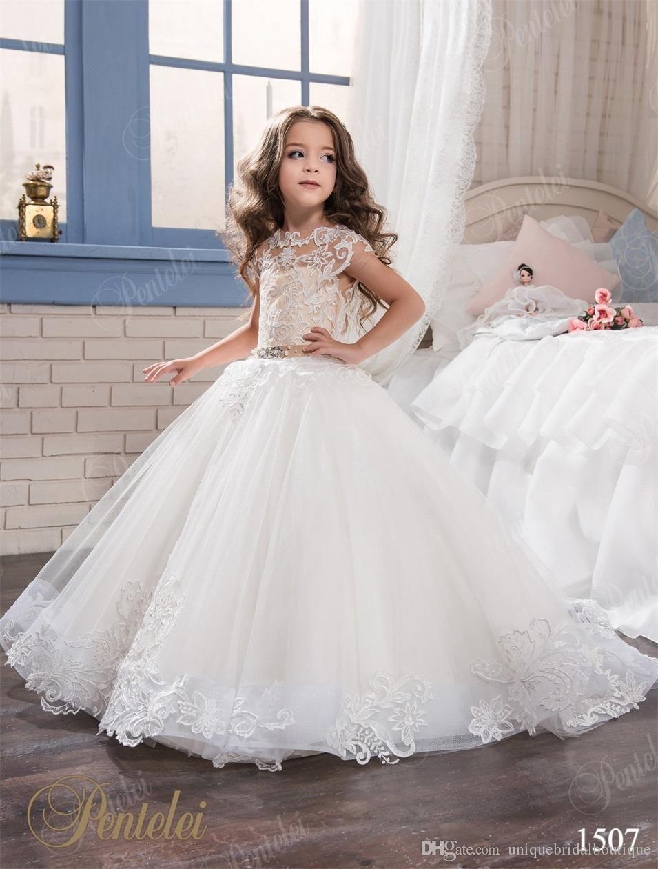 Kids wedding dresses pentelei with cap sleeves and sweep train