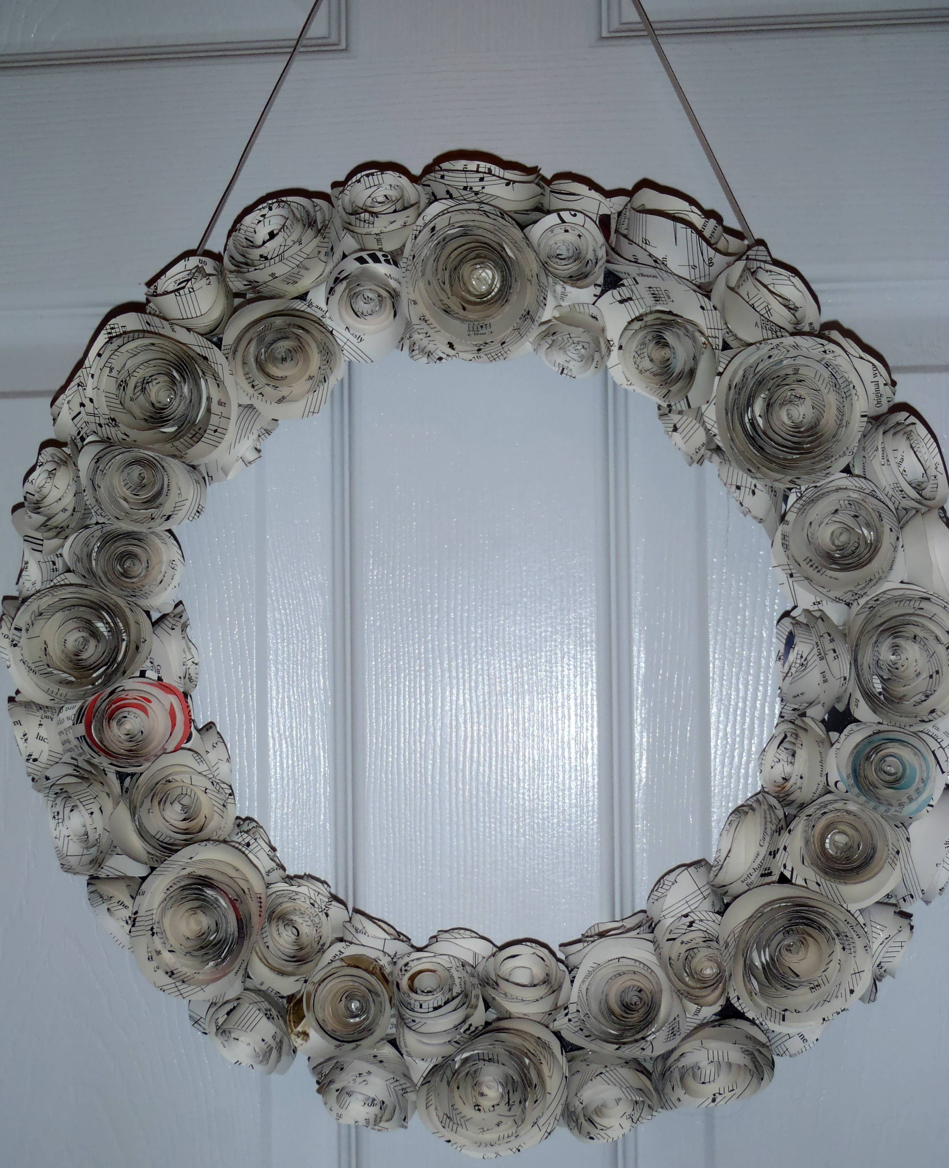 Musical wreath - via @Tiffany Butterworth    Just make rolled up flowers out of sheet music and put on wreath base (I used foam piping from Home Depot). So classy!