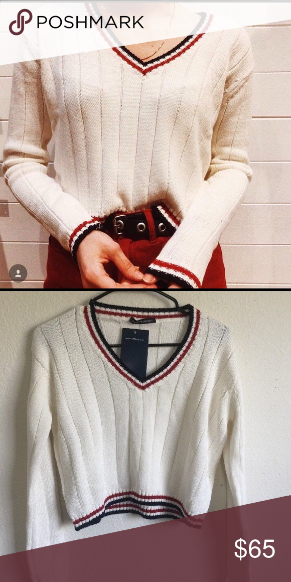 2321b3f5bf Brandy Melville v neck Nicole sweater Thick knit cotton v-neck sweater in  creme with blue and red stripe trimmings. Fabrics: 100% cotton  Measurements: 18