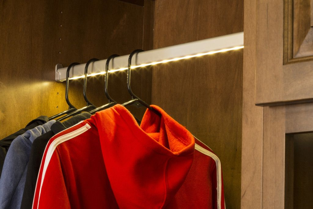 LED lights are integrated into this closet rod by Hafele