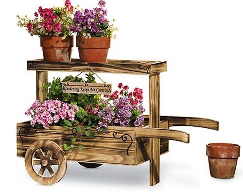 Rustic Wooden Wheelbarrow Planter Along The Garden Path