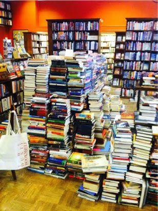 The Dusty Bookshelf Manhattan Ks Books Stacked On Books
