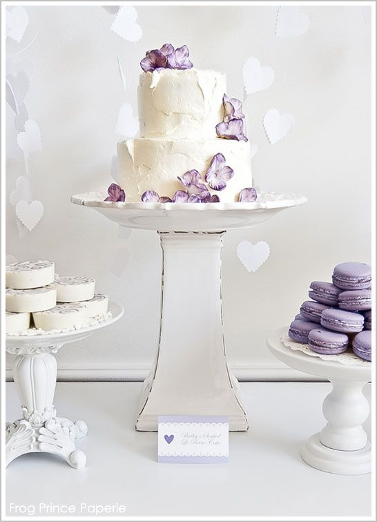 gorgeous lavender wedding cake with lavender macarons, lilac cakes and a vintage white cake stand. #gorgeous