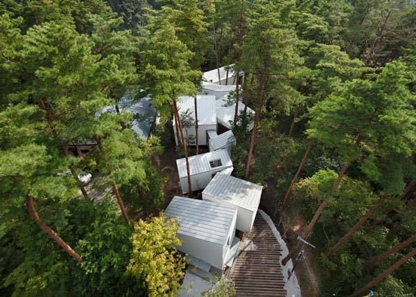 7.) Residence of Daisen (Japan). Instead of clearing out a forest for this home, designers built the structure to naturally weave in and out of the trees.