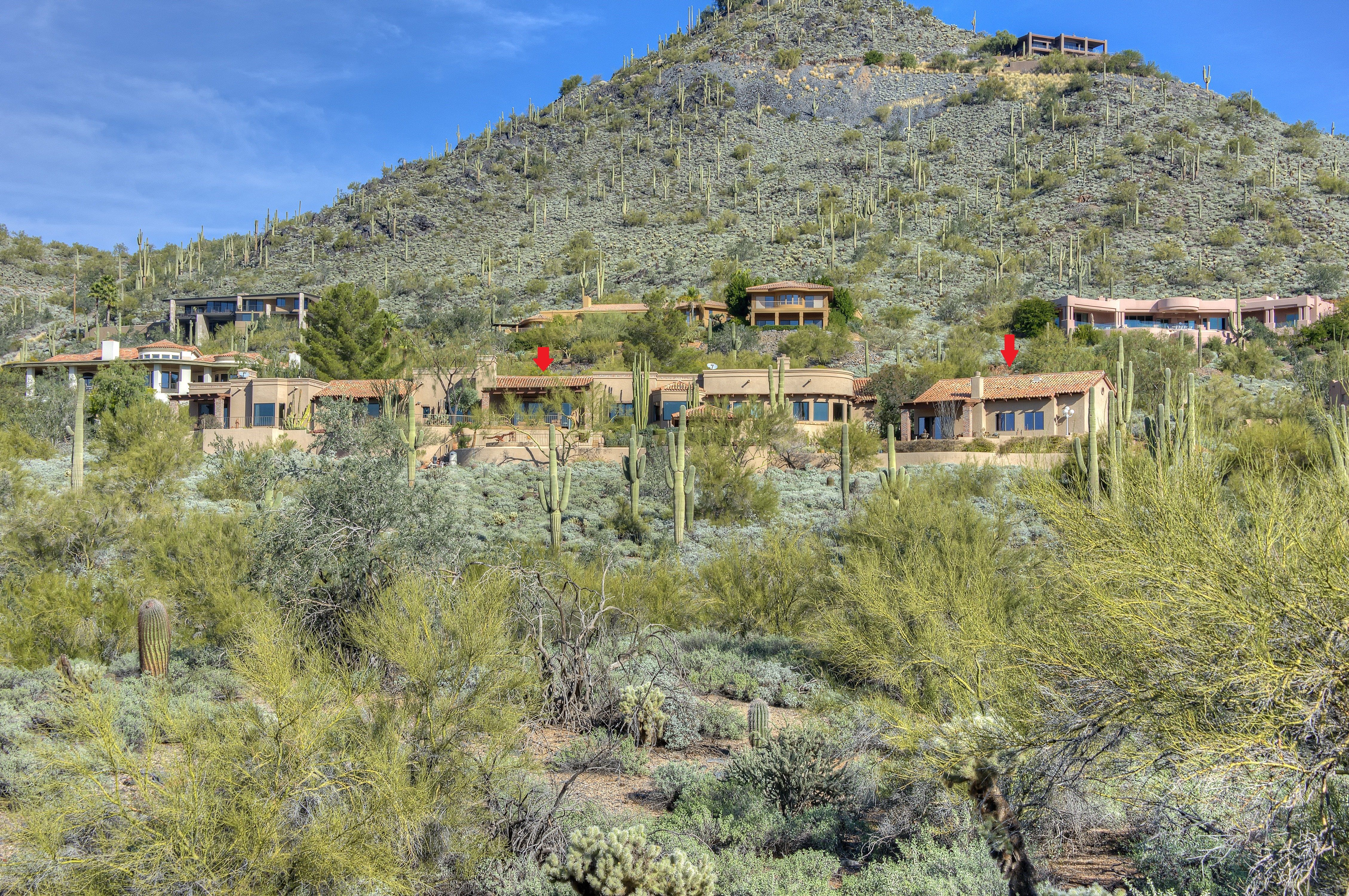 Panoramic views from this elegant single level home on Black Mt with 1100 sq ft guesthouse, pool, spa, 4 car tandem garage