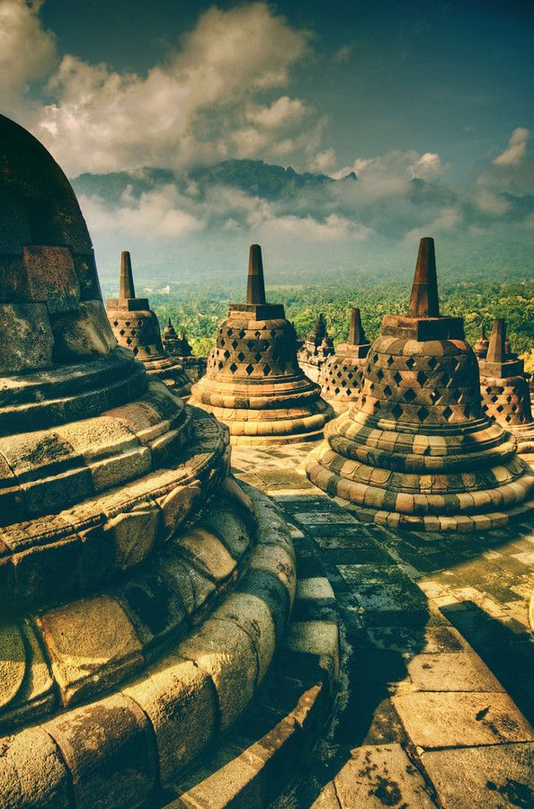 The old temple of Borobudur with the stupa-cages that protect the stone buddas that sit inside. Stuck in Customs