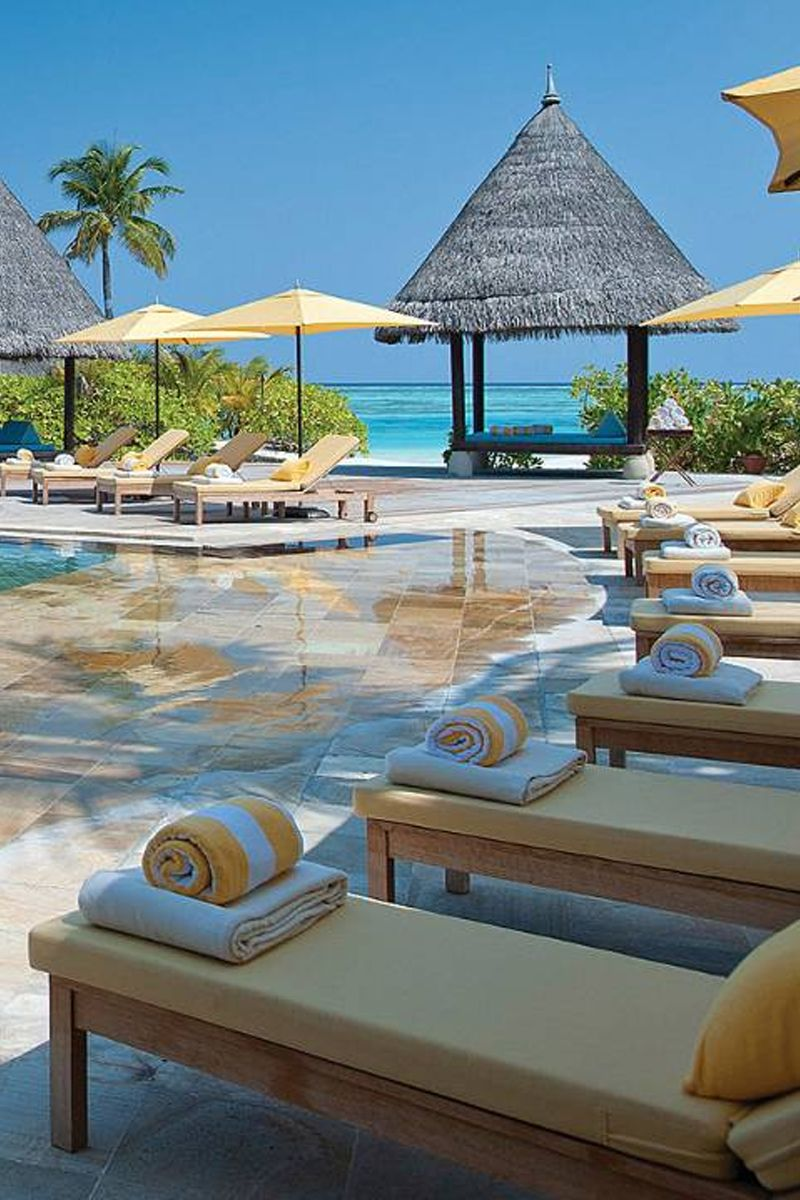 Enjoy poolside relaxation at Four Seasons Maldives
