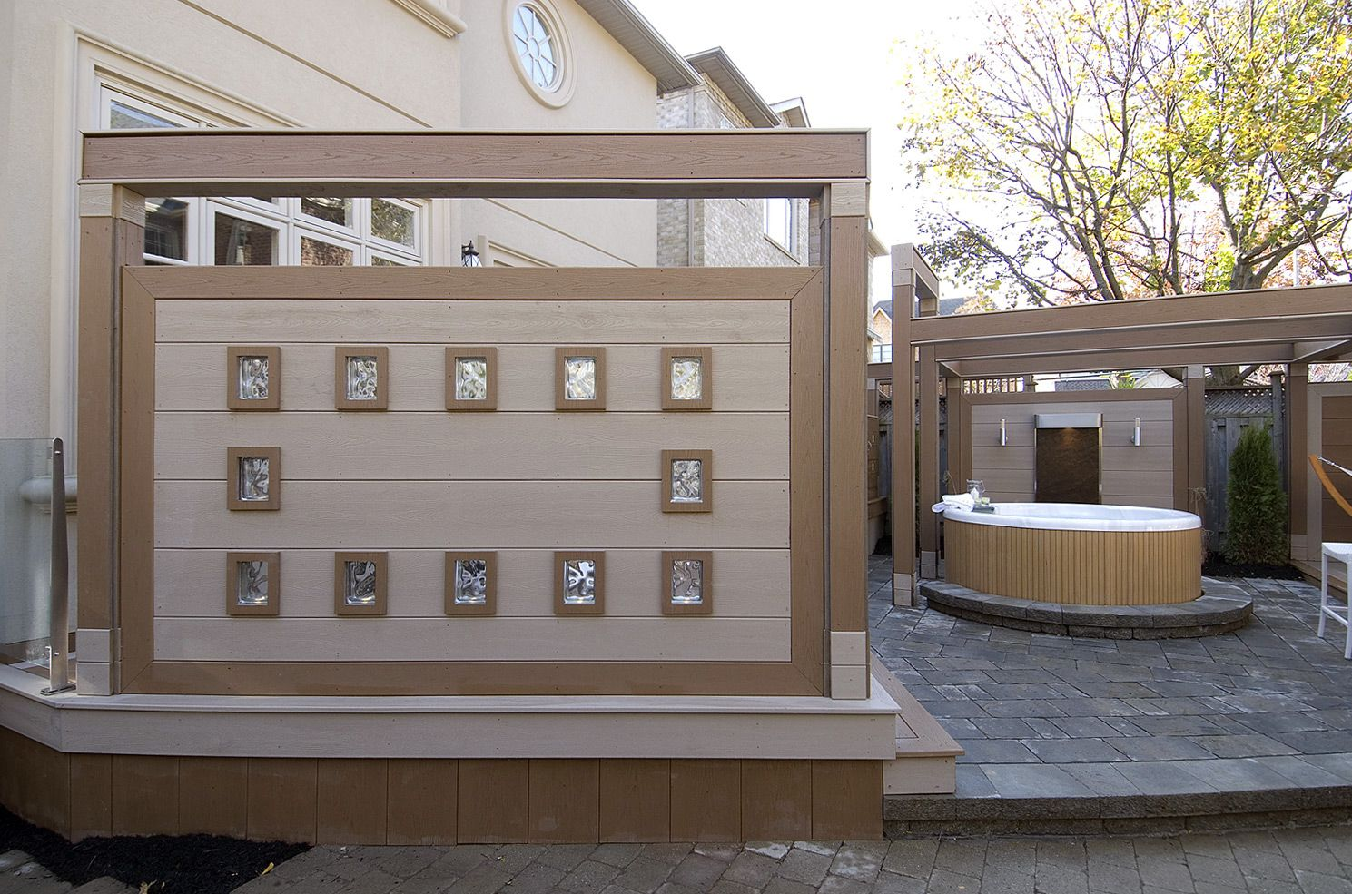 """We set off this privacy screen with some cool glass inserts.  From """"Decked Out"""" project """"The Clock Deck"""".  Deck Design by Paul Lafrance Design."""