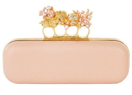 Alexander McQueen's famous knuckle-ring clutch bag has just been re-worked in soft pink napa leather with pearl, crystal and gold detailing