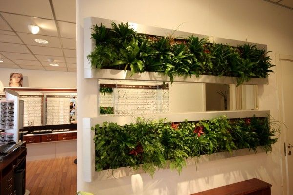 An even more vertical solution, this wall with built in planters is ...