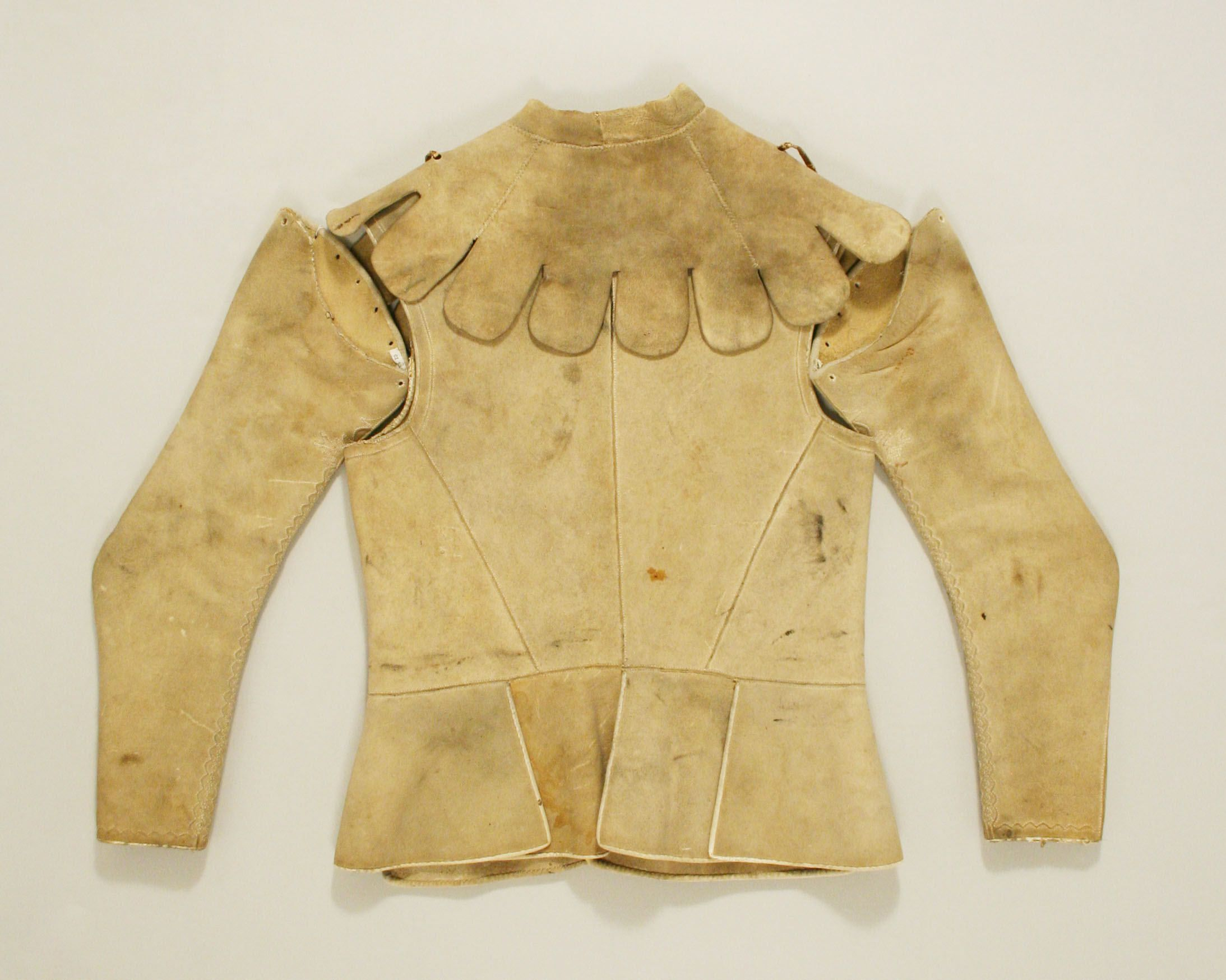 17th century jacket in 5 parts (the base vest and attachable sleeves and collar, back pictured) made of leather, The Metropolitan Museum of Art C.I.50.98.4a–d