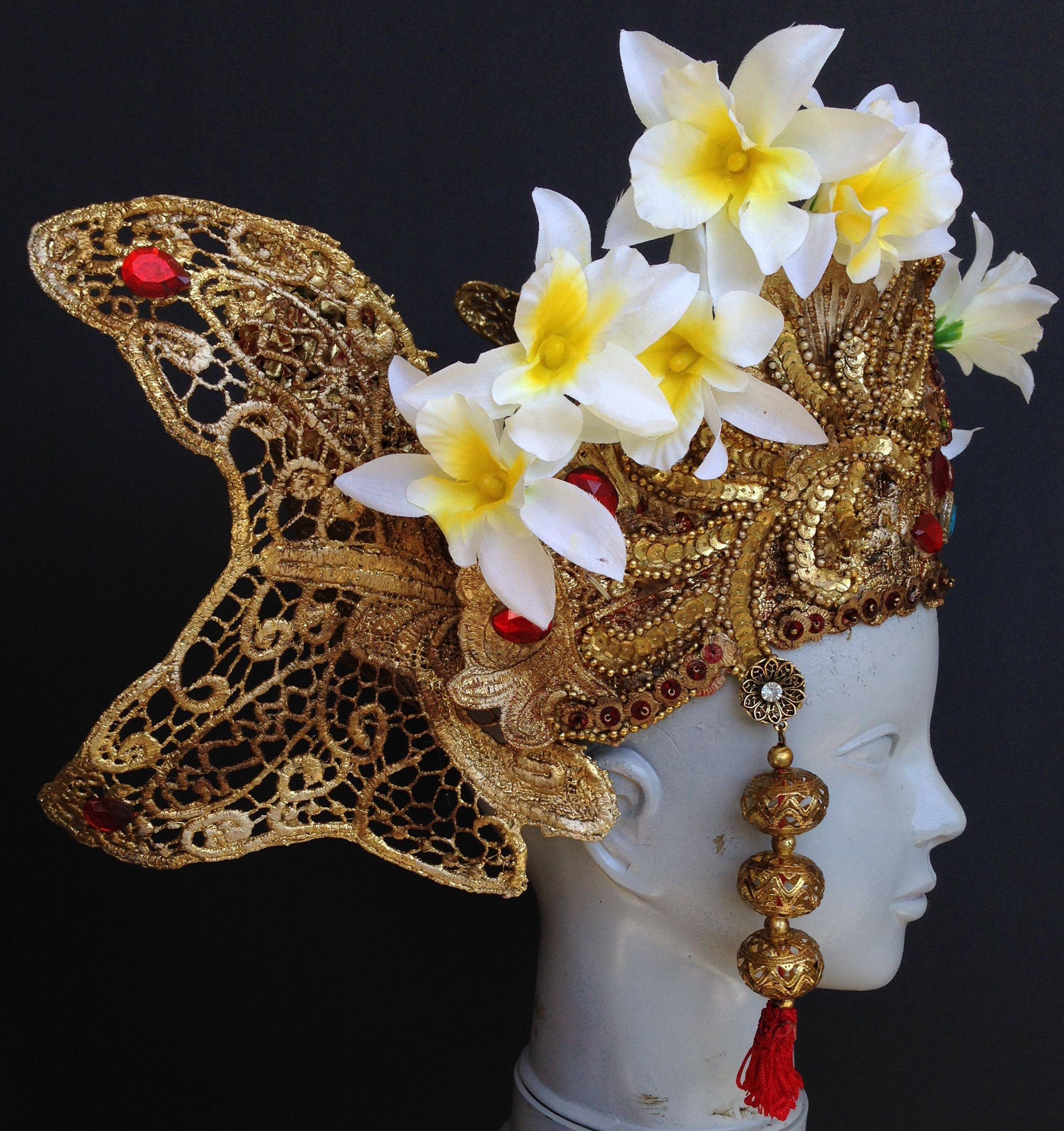 Kristine Berg. Indonesian Dancer head dress made for a commercial. Plastic doilies, lace, paint, rhinestones, fake flowers, found objects.