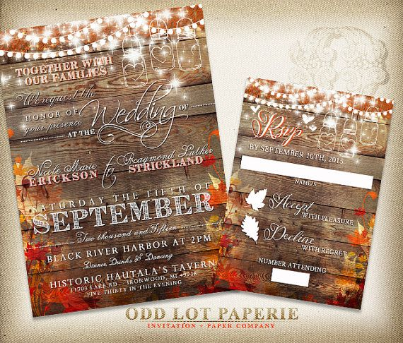 Rustic Fall Wedding Invitation On A Barn Wood Background With Leaves Hanging Light And