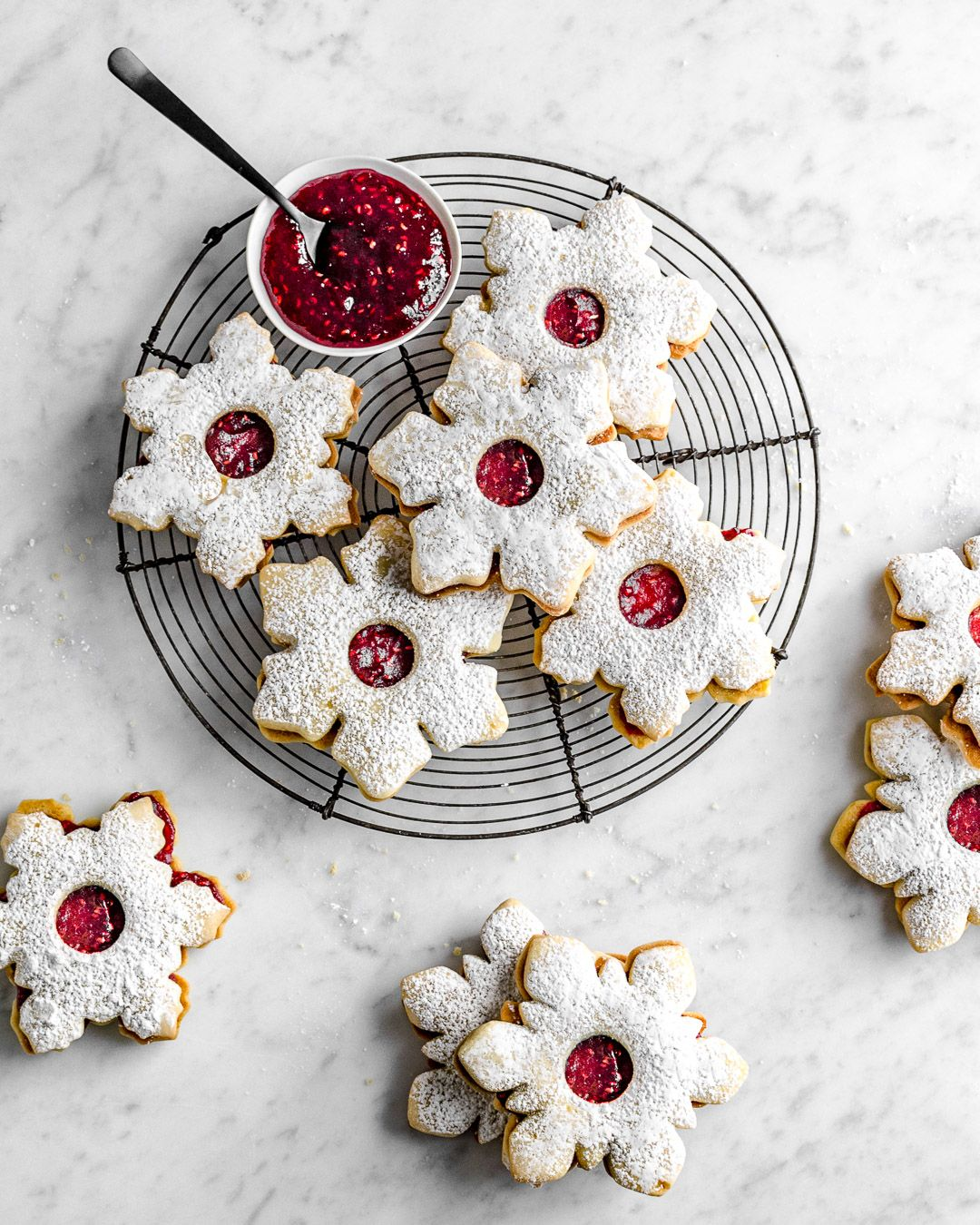 Linzer Christmas Cookies With Powdered Sugar And Raspberry Jam From