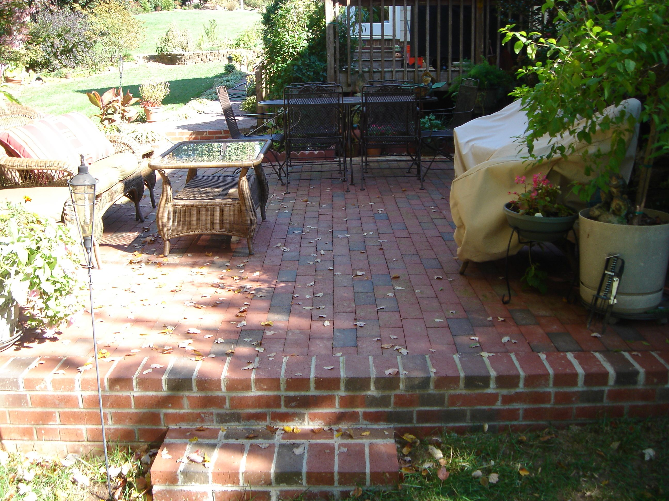 Awesome Gorgeous Brick Patio With Retaining Wall And Brown Resin Wicker Outdoor  Chairs Also Orange Garden Seat Pads Under Teal Blue Throw Pillow Covers Of  Patio ...