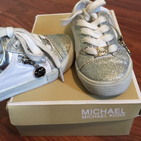 RARE Michael Kors Malaga Toddler sneakers shoes Size 8 toddler's Michael Kors Lil Malaga 4 sneakers shows. Worn but good condition some minor dirt which prob can be cleaned. Comes in orig box Michael Kors Shoes Sneakers