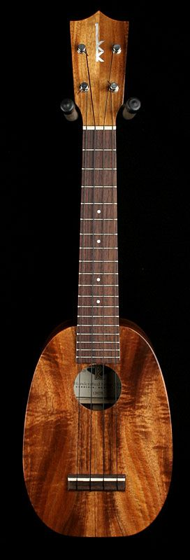 Kamaka Ukuleles HP-1LK...  Love the pineapple shape without the painting, just let the wood show.