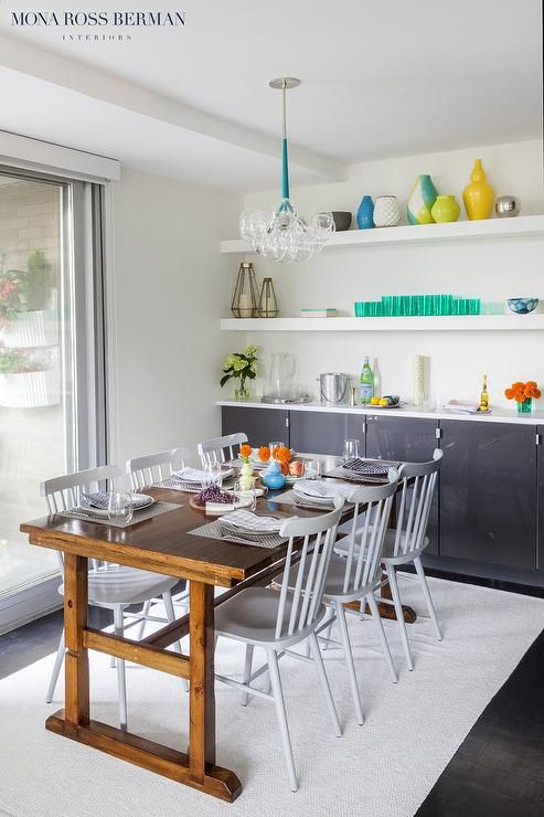 Chic Dining Room Features Long White Floating Shelves Suspended Over Gray Lacquered Built In