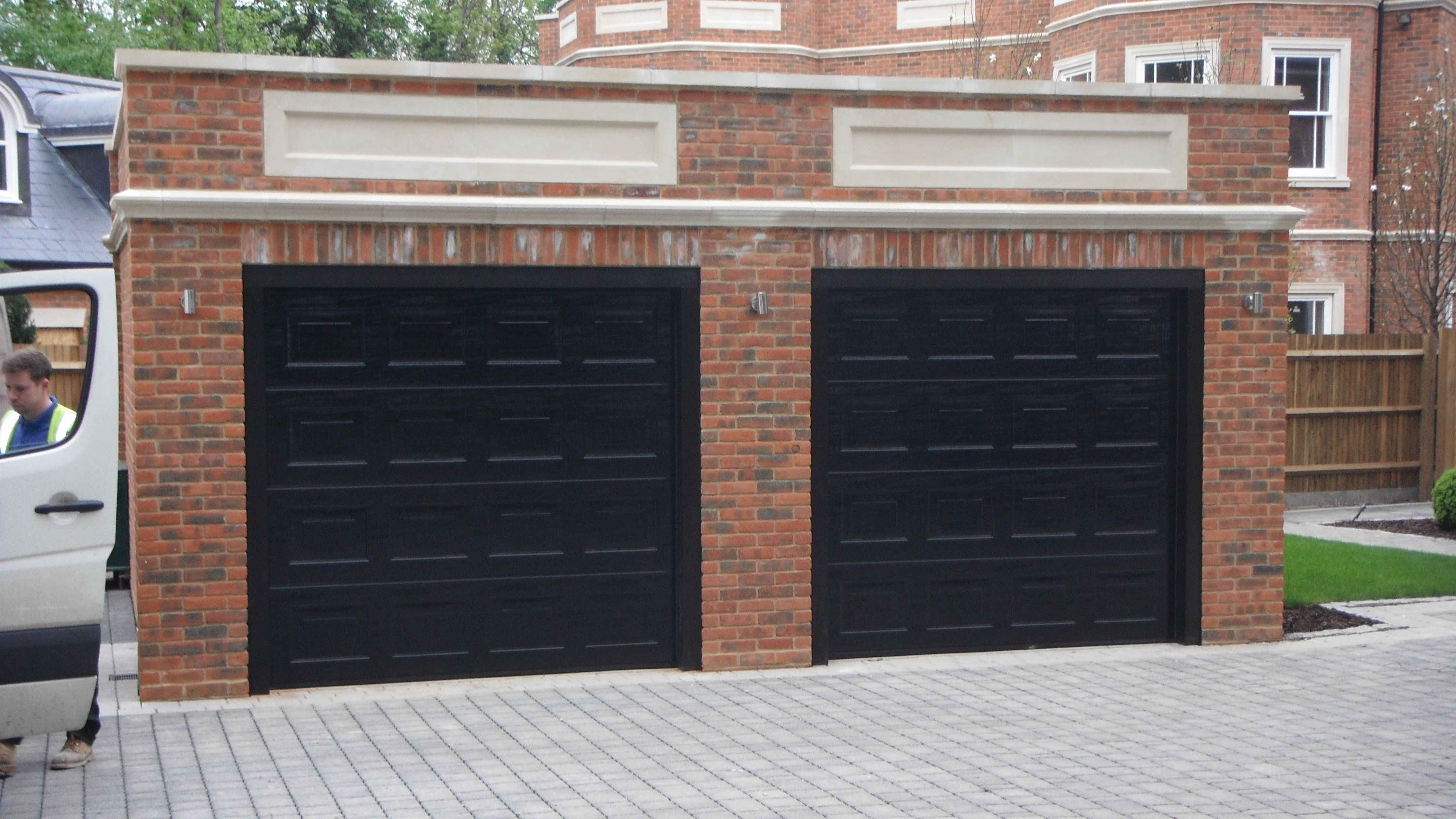 Two S Panelled Woodgrain Hormann Lup40 Sectional Doors With Automation Swr Redefining Homes Garage Doors Sectional Door Sectional Garage Doors