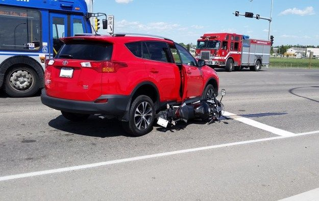 Image result for car runs over motorcycle