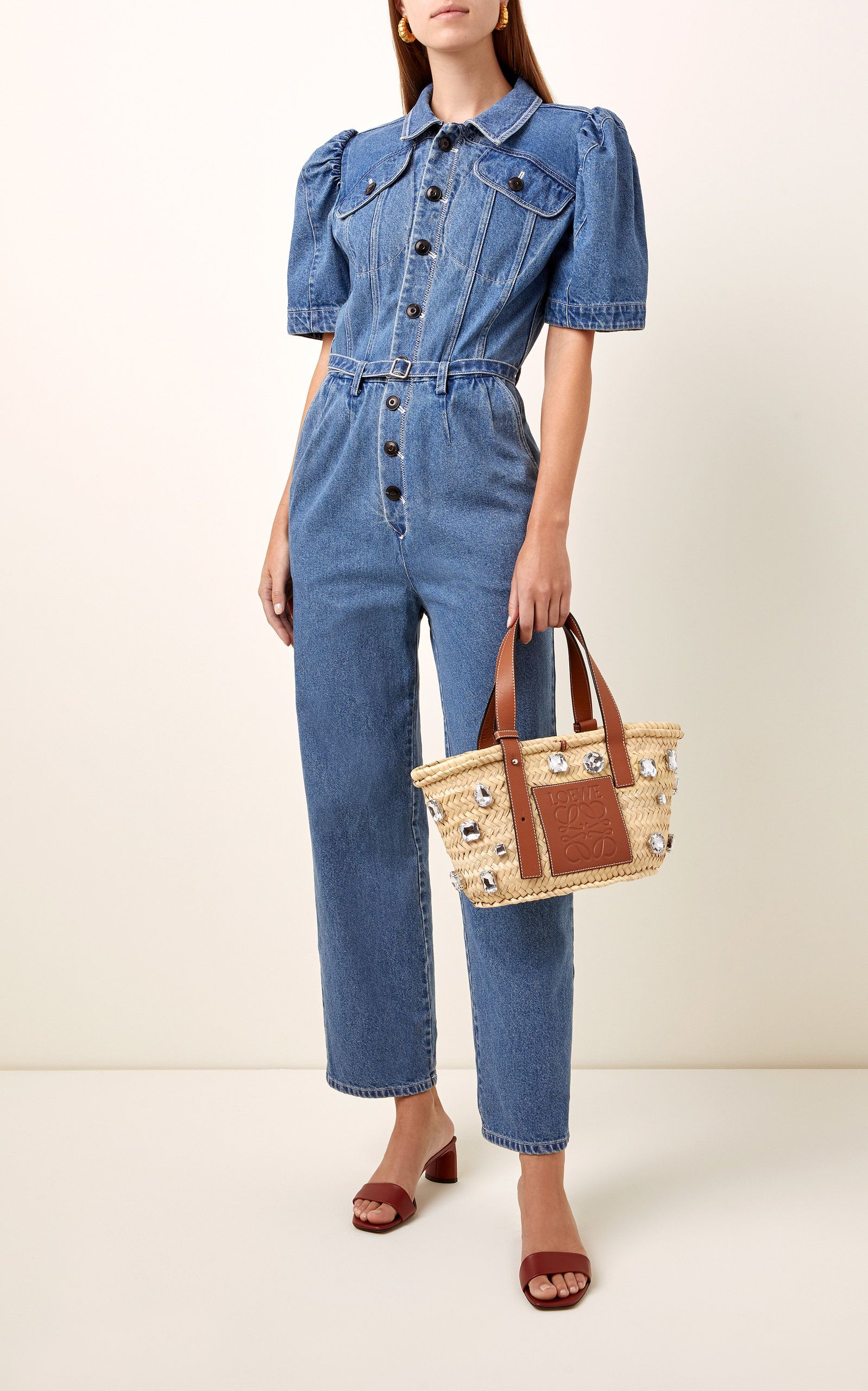 Sea's jumpsuit combines utilitarian elements with ultra-feminine details. It's cut from structured denim and has puffed sleeves and a straight-leg hem. The darted bodice defines your frame while the detachable belt allows you to cinch the waist.