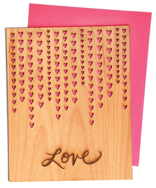 """love"" laser-cut printed on wood"