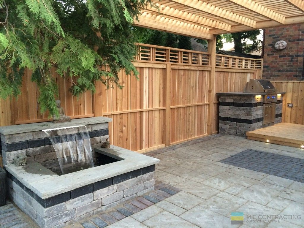 Outdoor Kitchen, Interlocking Patio Waterfall And Cedar Fence .