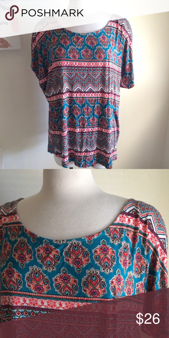 Printed tee Beautiful tee! It has bright colors and patterns. It has teal, red, orange, and white. Rounded neckline. Short sleeves. It's very stretchy!! It's soft and comfortable. 97% rayon and 3% spandex. Size 18/20. Avenue Tops Tees - Short Sleeve