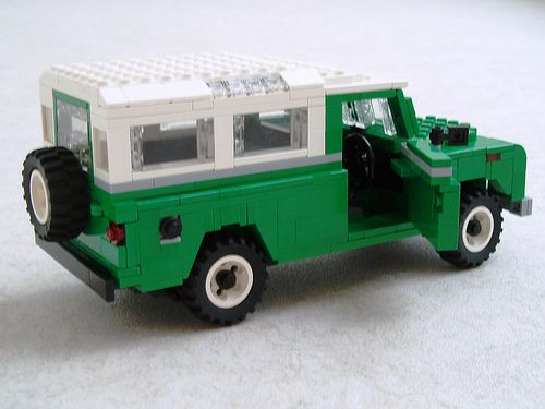 One of the things I worried about before building this was what wheels and tyres I was going to use. I knew I'd have to end up improvising, because LEGO doesn't produce the intermediate size I wanted. My LAFD Suburban has a wheel and tyre combo that has the right size, but I wanted white rims and the tyres on the Suburban look too low-profile. I experimented with a few things before I came up with the result: a Tire 30.4 x 14 Offset Tread wrapped around a Wheel 30.4 x 14 VR. The tyre is…