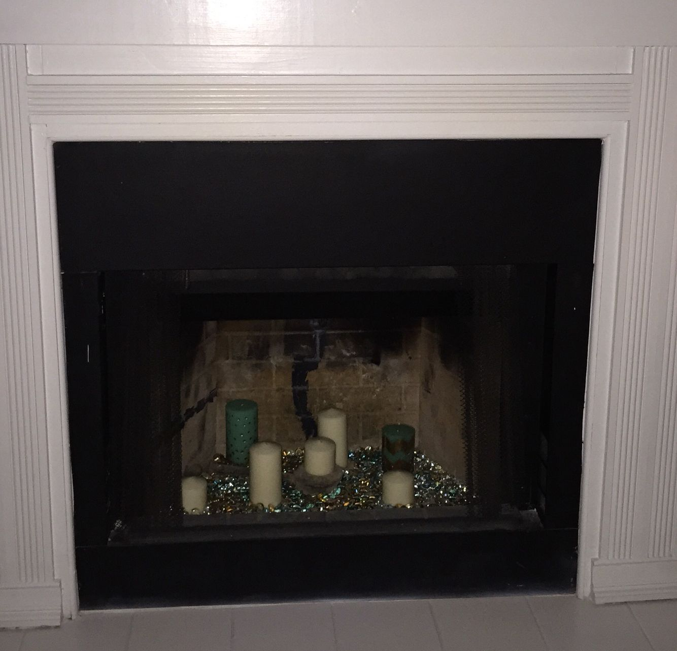 fire place decor candles glass rocks home sweet home