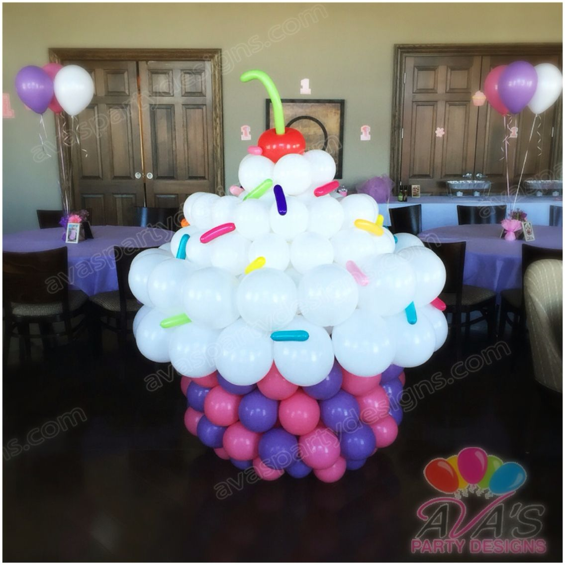 Giant Balloon Cupcake Sculpture. Great addition for your candy land theme party.