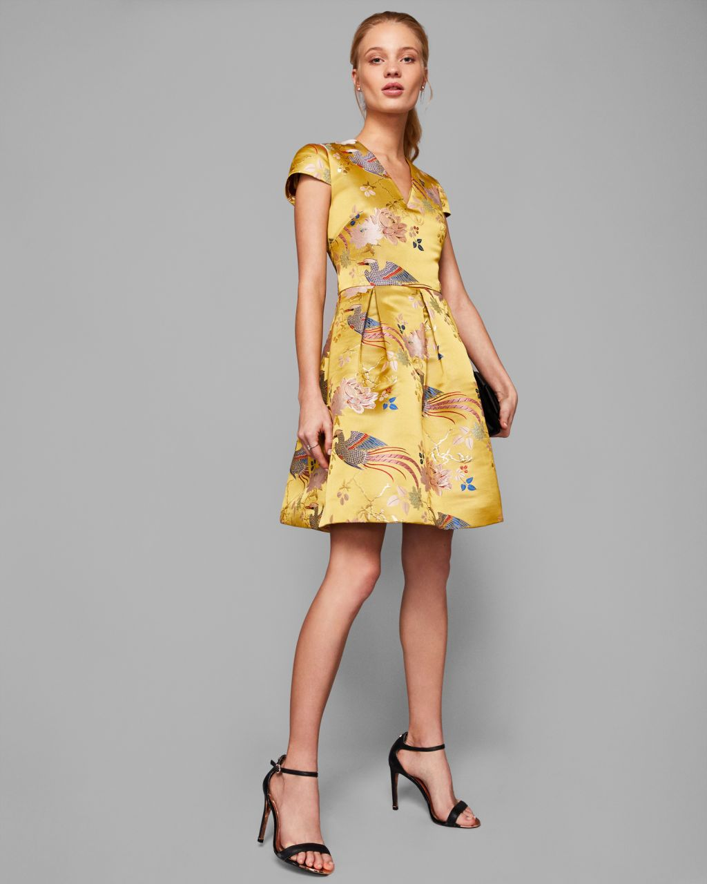 2da9474ee Ted Baker s yellow Denys dress is perfect for a modern wedding guest. This  stunning jacquard dress features a V neckline