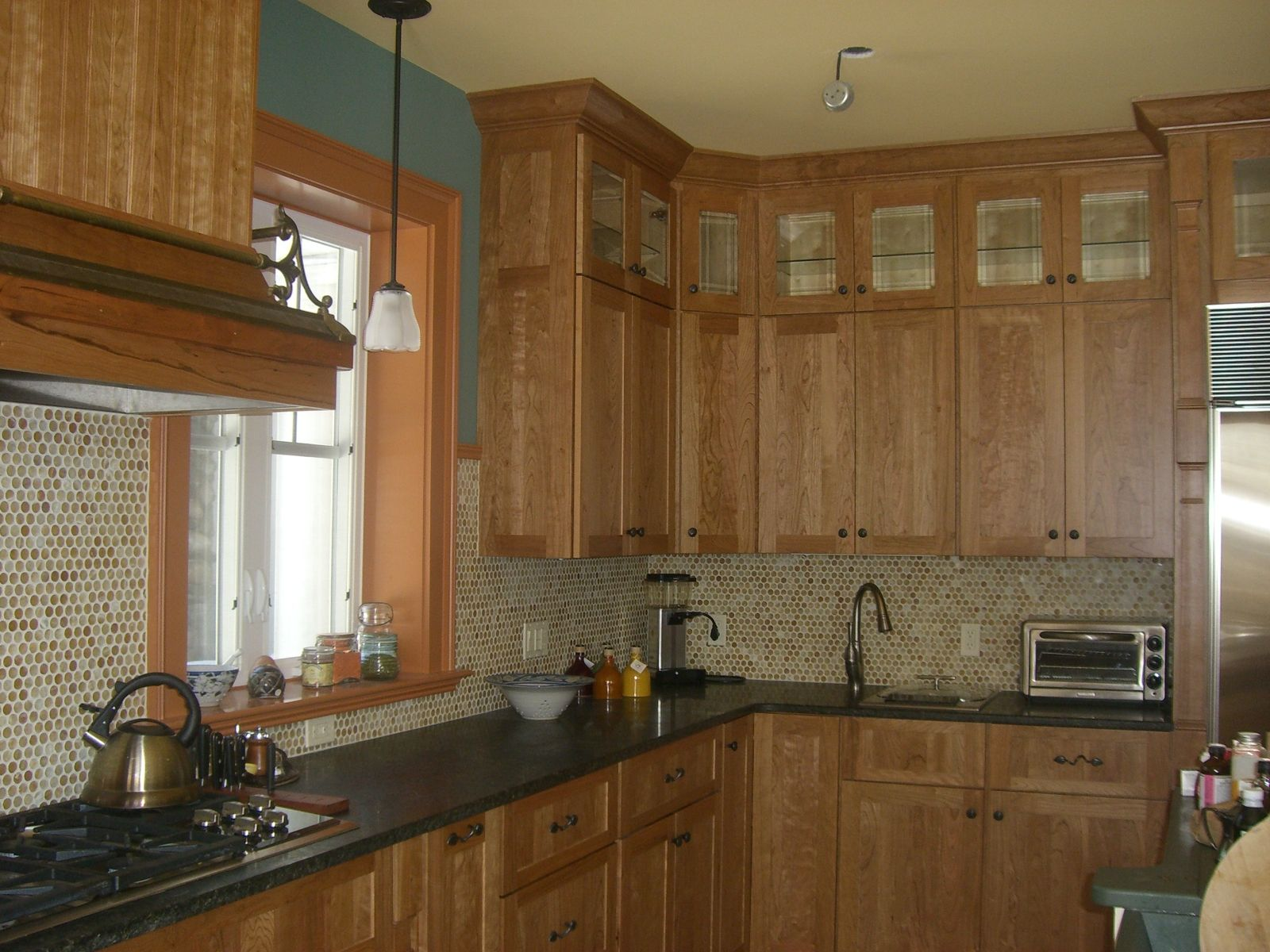 dark counter light backsplash condo kitchen kitchen remodel upper cabinets on kitchen cabinets upper id=86300