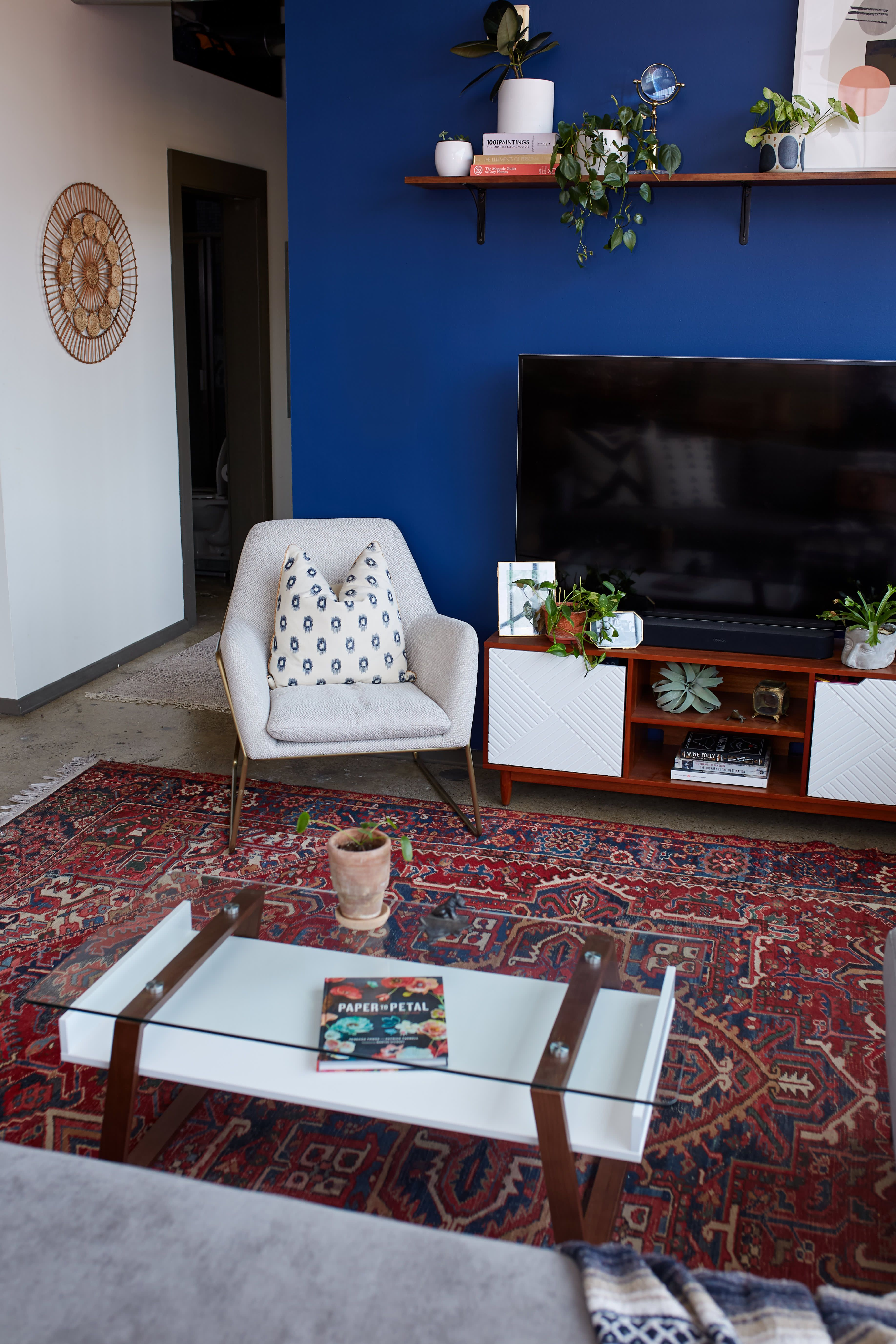 A Bold Blue Accent Wall Is Just One Of The Beautiful Things About This Knoxville Apartment Blue Accent Walls Blue Accent Wall Living Room Accent Walls In Living Room