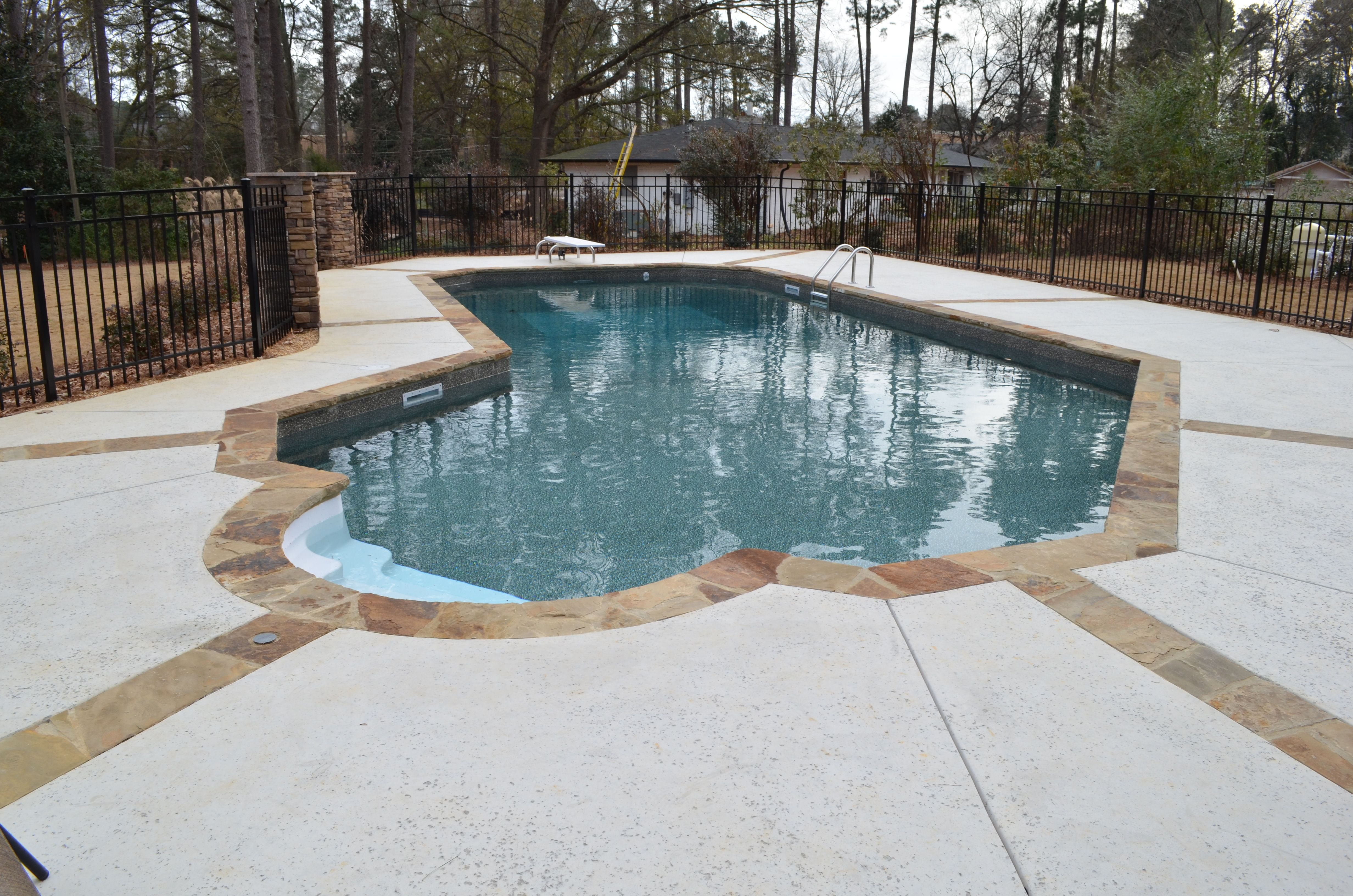 Lazy L Swimming Pool Stone Expansion Joints Salt Pitted Concrete Decking Cool Swimming Pools Swimming Pools Pool Builders
