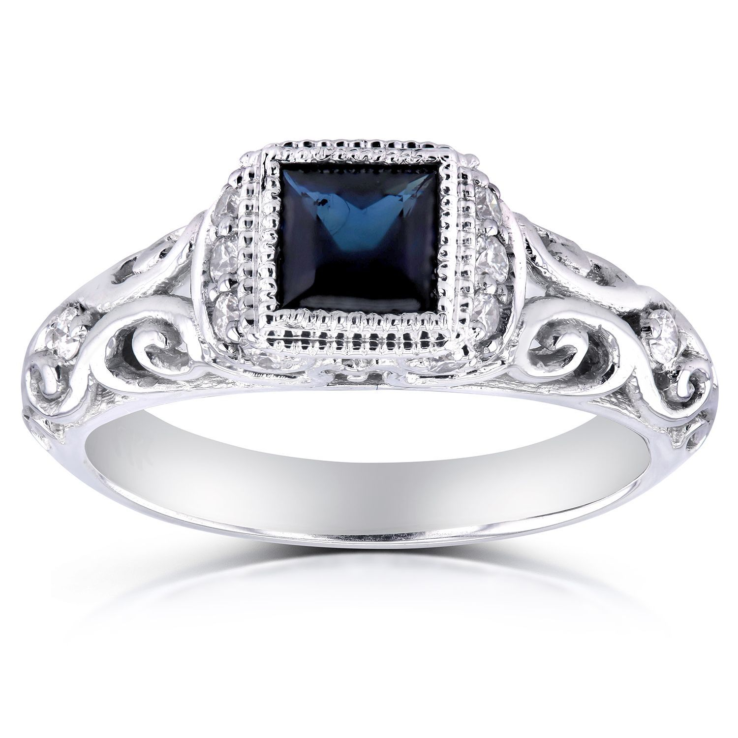 Sapphire and diamond antique style engagement ring in karat white