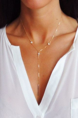 """A dainty statement Y-style necklace with a trio of cubic zirconia solitaires and a flat modern vertical bar drop. Necklace measures approx. 18"""" in length with a 3"""" drop. Looks great layered with a smaller necklace on top. Closure: Lobster clasp. Materials: 14k Gold Fill. Handmade in Corning, NY"""