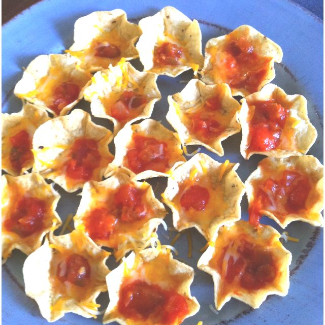Mini nacho bowls! Tostitos scoops with cheese & salsa! (add other ingredients too)  Heat for 30 sec in micro or heat in oven until cheese melted!!