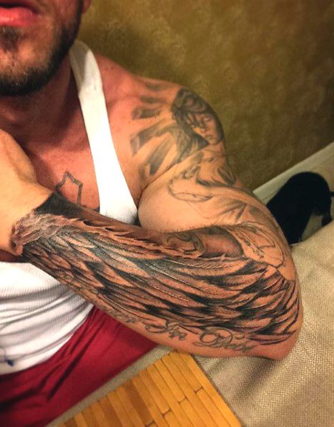 Forearm mens wing tattoo in black ink tatuajes spanish for Mens wing tattoo