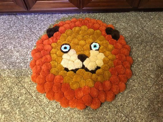 26 Diameter Lion Face Rug With Rich Orange And Gold Tones Loving Hy Blue Eyes To Welcome Your Child Lay On It Triple Knotted A Heavy Duty
