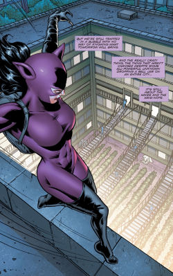 Catwoman in her sexy purple outfit