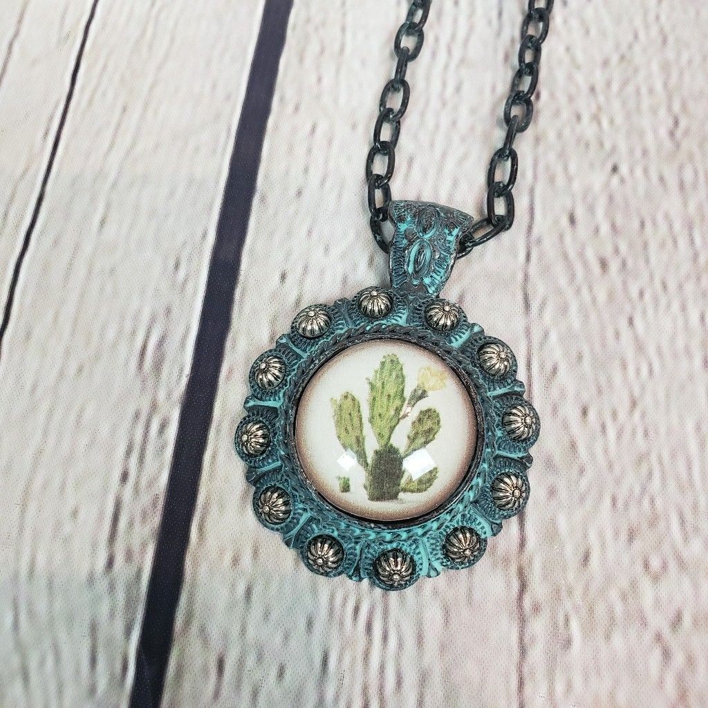 Boho western style faux turquoise cacti necklace. Patina with silvertone accents. #boho #western #bohowesternstyle #turquoise #turquoisejewelry #necklace
